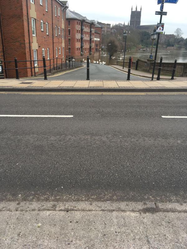 Provide drop kerb on Worcester Bridge
