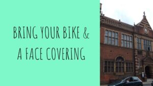 Bike & Face covering event outside MAG